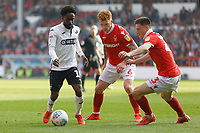 (L-R) Nathan Dyer of Swansea City closely followed by Jack Colback and Joe Lolley of Nottingham Forest during the Sky Bet Championship match between Nottingham Forest and Swansea City at City Ground, Nottingham, England, UK. Saturday 30 March 2019