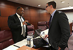 Nevada Assemblymen Jason Frierson, D-Las Vegas, left, and Wesley Duncan, R-Las Vegas, talk in committee at the Legislative Building in Carson City, Nev., on Thursday, Feb. 14, 2013..Photo by Cathleen Allison