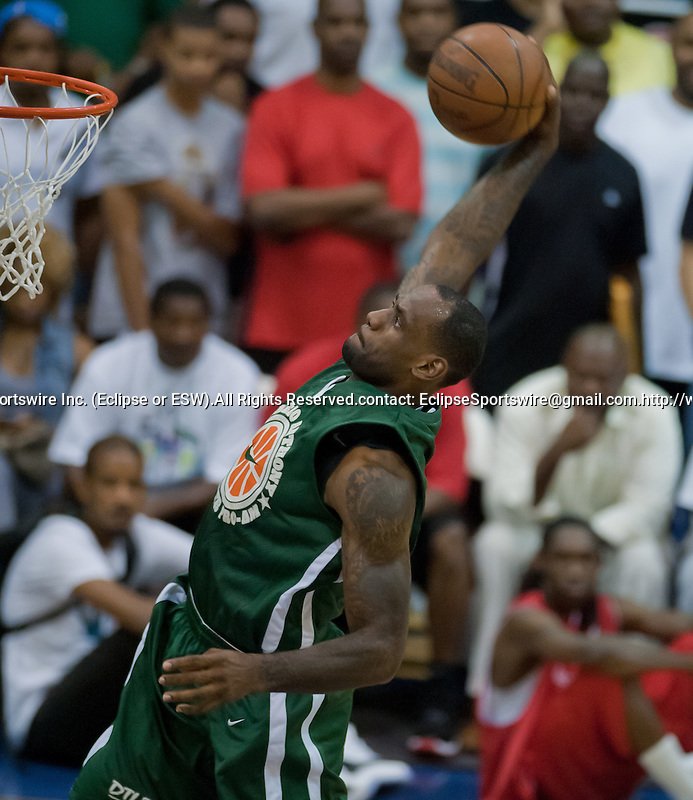 Lebron James slam dunks for the Melo All-Stars during the Summer League All-Star Game at Morgan State University on August 30, 2011.