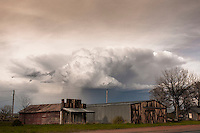 Cumulonimbus thunderstorm cloud above old abandoned buildings in Montana, May 18, 2014