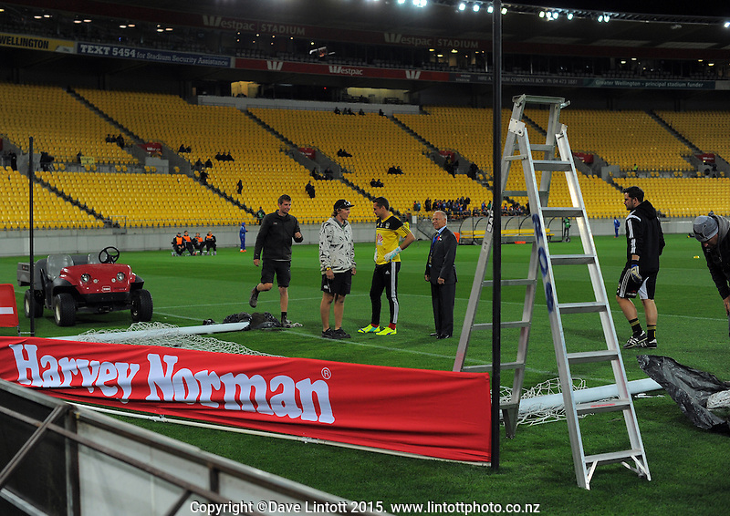 Stadium staff try to reset the south end goalposts before the A-League football match between Wellington Phoenix and Central Coast Mariners at Westpac Stadium, Wellington, New Zealand on Friday, 17 April 2015. Photo: Dave Lintott / lintottphoto.co.nz