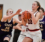 Civic Memorial center Claire Christeson (left) reaches in for a ball bobbled by Highland guard Ashlyn Klucker. Highland played Civic Memorial in the Class 3A Effingham sectional championship game at Effingham High School in Effingham, Illinois on Thursday February 27, 2020. <br /> Tim Vizer/Special to STLhighschoolsports.com