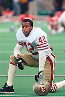 NEW ORLEANS, LA - Ronnie Lott of the San Francisco 49ers kneels on the field before Super Bowl XXIV against the Denver Broncos at the Superdome in New Orleans, Louisiana in January of 1990. Photo by Brad Mangin.