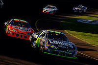 Nov 13, 2005; Phoenix, Ariz, USA;  Nascar Nextel Cup driver Jimmie Johnson driver of the #48 Lowes Chevy leads teammate Jeff Gordon during the Checker Auto Parts 500 at Phoenix International Raceway. Mandatory Credit: Photo By Mark J. Rebilas