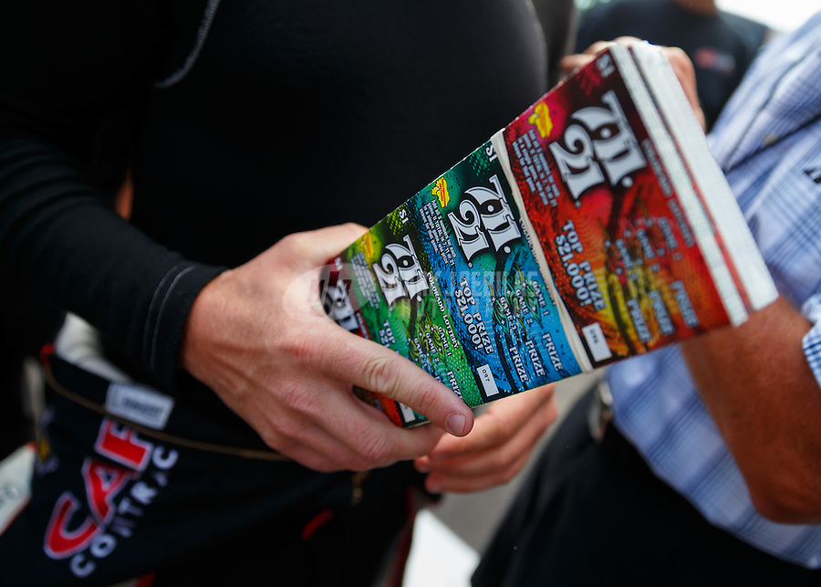 Jul 24, 2016; Morrison, CO, USA; Detailed view of 1000 dollars in lottery tickets in the hand of NHRA top fuel driver Steve Torrence during the Mile High Nationals at Bandimere Speedway. Mandatory Credit: Mark J. Rebilas-USA TODAY Sports