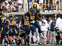 Chris McCain of California celebrates with Todd Barr of California in the air after making big play during 115th Big Game against Stanford at Memorial Stadium in Berkeley, California on October 20th, 2012.  Stanford defeated California, 21-3.