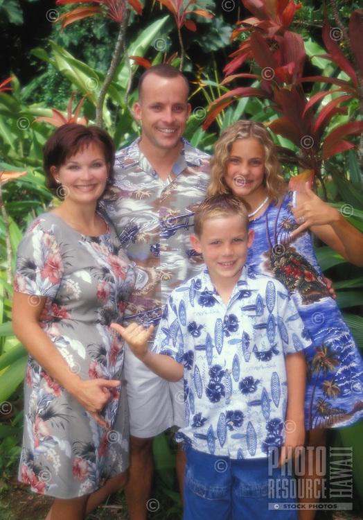 Tourist family in Aloha wear at Haiku Gardens, Kaneohe