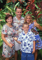 Tourist family in Aloha wear at Haiku Gardens, Kaneohe