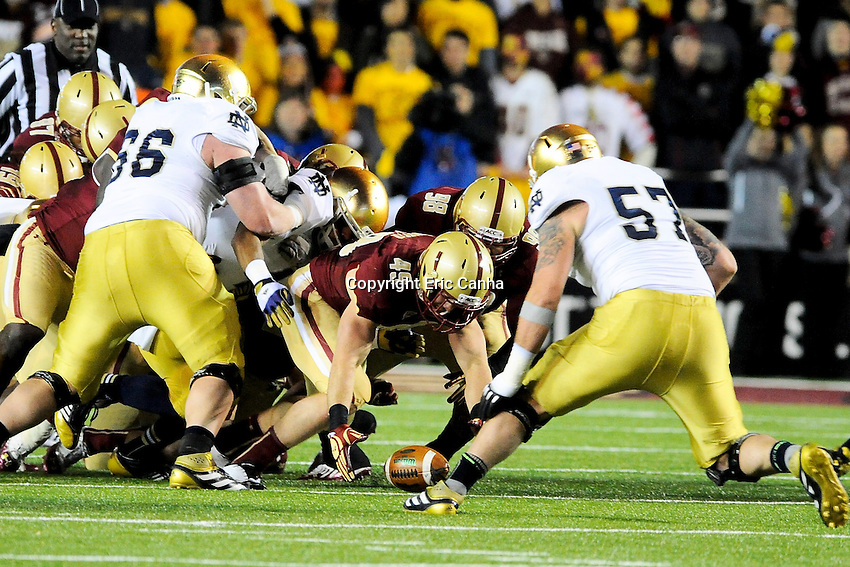 Boston College Eagles linebacker Steele Divitto (49) recovers a Notre Dame Fighting Irish fumble late in the second half during the Boston College Eagles vs Notre Dame Fighting Irish NCAA football game held at Alumni Stadium, in Chestnut Hill, Massachusetts.   Eric Canha/CSM
