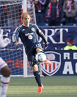 Sporting Kansas City defender Seth Sinovic (15) clears the ball.  In a Major League Soccer (MLS) match, Sporting Kansas City (blue) tied the New England Revolution (white), 0-0, at Gillette Stadium on March 23, 2013.