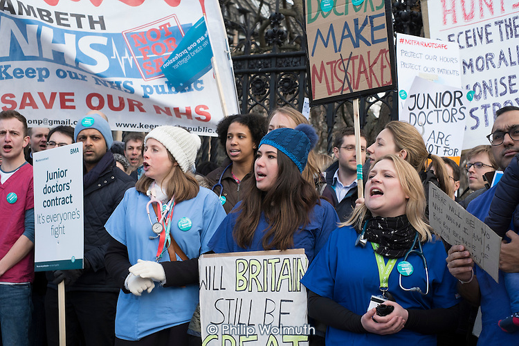 Junior doctors from London St Thomas's and Guy's hospitals on strike over a proposed new contract march with supporters across Westminster Bridge to protest outside the Houses of Parliament.