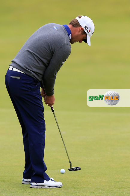 Marc WARREN (SCO) putts on the 18th green during Sunday's Round 3 of the 144th Open Championship, St Andrews Old Course, St Andrews, Fife, Scotland. 19/07/2015.<br /> Picture Eoin Clarke, www.golffile.ie