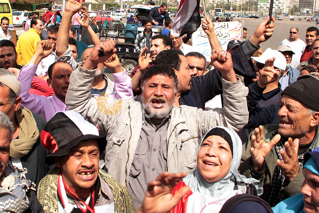 "Egyptian protesters gather in the highway street in Nasr City , to participate in Demonstration called ""Last chance"", in Cairo on March 15, 2013. Egyptians demonstrate in support of armed forces and mandating it to manage the governance in the country. Photo by Tarek al-Gabas"