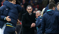 Swansea City manager Paul Clement celebrates with his coaching staff as the final whistle is blown at the conclusion of the Premier League match between Liverpool and Swansea City at Anfield, Liverpool, Merseyside, England, UK. Saturday 21 January 2017