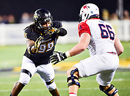 Baltimore, MD - OCT 14, 2017: Towson Tigers defensive end Kanyia Anderson (99) and Richmond Spiders offensive lineman Alex Light (66) battle it out in the trenches during game between Towson and Richmond at Johnny Unitas Stadium in Baltimore, MD. The Spiders defeated the Tigers 23-3. (Photo by Phil Peters/Media Images International)