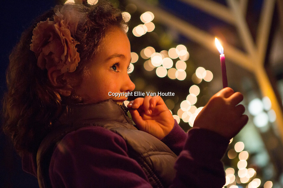 Los Altos resident Rachel Leah Schusterman, 6, holds a candle at the Los Altos Chabad's Annual Menorah Lighting at Main and State streets in Los Altos on the third day of Hanukah, Dec. 11.<br /> <br /> Photo by Ellie Van Houtte/Town Crier