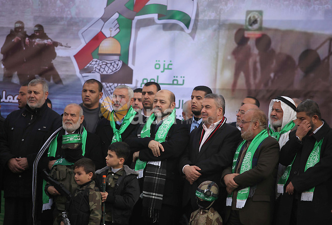 Hamas top leader in the Gaza Strip Ismail Haniya and Mussa Abu Marzuq attend a rally marking the 27th anniversary of Hamas' founding, in Gaza City December 14, 2014. Photo by Ashraf Amra