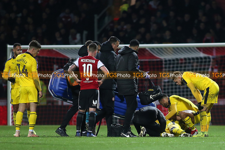 Oxford United players show their concern for Shandon Baptiste as he lies injured on the ground awaiting the stretcher during Brentford vs Oxford United, Emirates FA Cup Football at Griffin Park on 5th January 2019