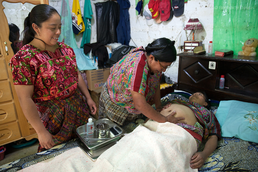 For GLOBAL FUND FOR WOMEN<br /> <br /> Gloria performs a prenatal exam on an eight months pregnant woman, during a training with Maia Pilar, a midwife with ACOTCHI. Gloria Marina Icu Puluc from Asociaci&oacute;n Civil de Comadronas Tradicionales de Chimaltenango (ACOTCHI) in San Juan Comalapa, Guatemala on August 20, 2015. Photo credit: B&eacute;n&eacute;dicte Desrus