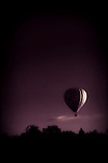 hot air balloon drifting in the night sky