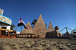 A Picture shows a wooden sculpture of the Pyramids of Giza at a technical site in the southern Gaza Strip town of Rafah, near the border with Egypt, on June 1, 2017. Young artists Palestinian artists Nidal Al-Jarami and Wissam Makkawi recreated Egypt's landmark sites with mural paintings and sculptures, including the Pyramids of Giza and a remake of an Umm Kulthum Cafe, named after the late Egyptian diva who died in 1975. Photo by Mohammed Dahman