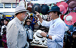 Peter Greenberg and President Correa shopping for hats in a crowded marketplace in Otavalo Ecuador.<br />