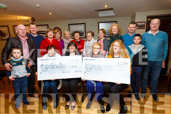 The Francis Curran Memorial Christmas Day Swim in Ballinskelligs raised €8,000, pictured here at the cheque presentation in Tig Rosie's Dungegan to the two nominated charities on Saturday night last were front l-r; Mary Walsh(Chairperson Ballinskelligs Community Care), Evelyn Goggin, Kathleen Lynch(Irish Cancer Society Rep), Síle Ní Chonaill, bck l-r; Kevin O'Sullivan, Dessy Cronin, Kieran O'Sullivan, Maire Uí Leidhin, Barbra Cassidy, Rosie Sigerson, Teresa Cronin, Sheila O'Sullivan, Marie Cronin, Catherine Curran, Michéal O'Sullivan, Sean O'Sullivan & Michael Curran.