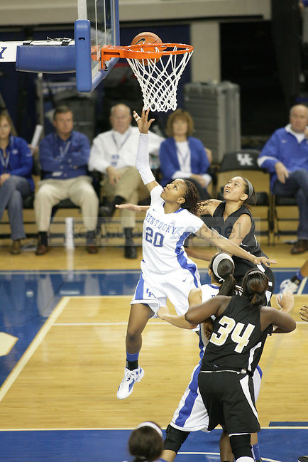UK's Maegen Conwright lays the ball up against Arkansas Pine-Bluff at Memorial Coliseum on Sunday, Dec. 11, 2011. Photo by Scott Hannigan | Staff