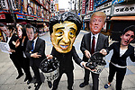 JUNE 28, 2019 - People wearing masks of G20 leaders protest coal power during the G20 Summit in Osaka, Japan. (Photo by Ben Weller/AFLO) (JAPAN) [UHU]