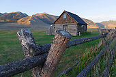 Log Cabin and Rail Fence in Field