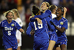 02 December 2011: Duke's Kim DeCesare (19) celebrates her goal with teammates (from left), Kaitlyn Kerr (5), Katie Trees, and Natasha Anasi (4). The Duke University Blue Devils played the Wake Forest University Demon Deacons at KSU Soccer Stadium in Kennesaw, Georgia in an NCAA Division I Women's Soccer College Cup semifinal game.
