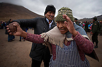 Oruro, Bolivia<br /> A picture dated January 12, 2015 shows Bolivian President Evo Morales holding the hand of a lady while his helicopter was refueled in the Bolivian Altiplano.