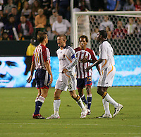 LA Galaxy midfielder David Beckham (23) argues with Chivas midfielder Jessie Marsch (15) while Galaxy forward Edson Buddle (14) and Chivas midfileder Lawson Vaughn (25) look on. CD Chivas USA defeated the LA Galaxy 3-0 in the Super Classico MLS match at the Home Depot Center in Carson, California, Thursday, August 23, 2007.