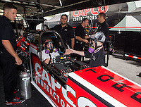May 17, 2014; Commerce, GA, USA; Crew members for NHRA top fuel dragster Steve Torrence during qualifying for the Southern Nationals at Atlanta Dragway. Mandatory Credit: Mark J. Rebilas-USA TODAY Sports