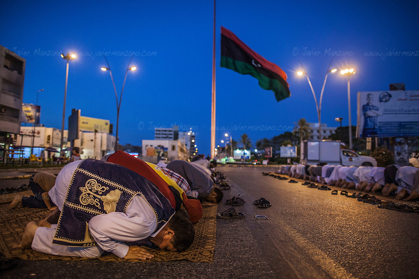 MISRATA, LIBYA &mdash; <br /> <br /> Dozens of Misrata citizens gather to pray after attending a protest on Tripoli street (one of the main avenues in the city that saw some of the worst battles of 2011). The protest was organized to voice their discontent on what they perceive is General Haftar's alliance with Egypt's Sisi government.