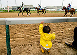 LOUISVILLE, KENTUCKY - MAY 02: A young fans watches as horses exercise in preparation for the Kentucky Derby and Oaks at Churchill Downs in Louisville, Kentucky on May 2, 2019. Scott Serio/Eclipse Sportswire/CSM