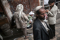 Monday 13 July, 2015: A Khat seller and consumers are seen in a market place in the Old City of Sana'a, a 2,500-year-old cultural heritage site endangered after a fighter jet of the Saudi-led coalition bombed and destroyed a line of residential tower-houses killing 4 residents and reducing to rubble the historial site. The ongoing aerial campaign of bombardments by the Arab states and their western allies led by Saudi Arabia and the heavy fighting against the entrenchment of the Houthi insurgency along the Yemeni main cities from north to south has caused an international alert for the enlisted cultural heritage sites in Yemen, such as the historic town of Zabid, the Old City of Sana'a and the Old Walled City of Shibam. (Photo/Narciso Contreras)