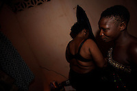 Rosina, 16 years old, on right, a young sex slave, prepares to cross the boarder with Togo searching for customers while  Hanna, her owner, gets ready for another night in her neighborhood in Aflao in the Volta Region, Ghana on Friday March 09 2007..