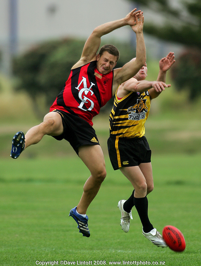 Jimmy Gopperth contests a high ball during the Preseason Cross-code Rugby Union v Australian Rules friendly between the Hurricanes and Wellington Tigers at  Elsdon Park, Porirua, New Zealand on Tuesday, 15 January 2008. Photo: Dave Lintott / lintottphoto.co.nz