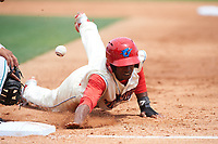 Clearwater Threshers Malquin Canelo (6) dives back to first base during a game against the Daytona Tortugas on April 20, 2016 at Bright House Field in Clearwater, Florida.  Clearwater defeated Daytona 4-2.  (Mike Janes/Four Seam Images)