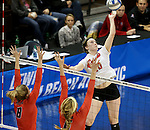 SIOUX FALLS, SD - DECEMBER 8:  Maddie Seliga #20 from Lewis tries to get the ball past Sydney Obringer #8 and Haley Kindall #6 from Wheeling Jesuit during their quarterfinal match at the 2016 Women's Division II Volleyball Championship at the Sanford Pentagon in Sioux Falls, SD. (Photo by Dave Eggen/Inertia)