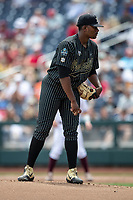 Vanderbilt Commodores pitcher Kumar Rocker (80) looks to his catcher for the sign during Game 8 of the NCAA College World Series against the Mississippi State Bulldogs on June 19, 2019 at TD Ameritrade Park in Omaha, Nebraska. Vanderbilt defeated Mississippi State 6-3. (Andrew Woolley/Four Seam Images)