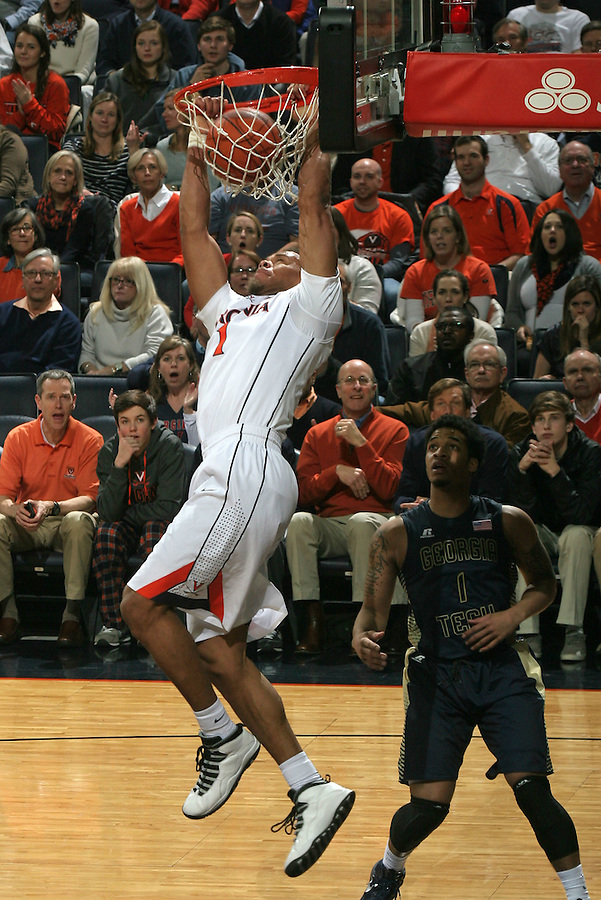 Virginia guard Justin Anderson (1) dunks the ball in front of Georgia Tech guard Tadric Jackson (1) during an NCAA basketball game Thursday Jan. 22, 2015, in Charlottesville, Va. (Photo/Andrew Shurtleff)