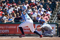 Rhys Hoskins (12) of the Lehigh Valley Iron Pigs follows through on his swing against the Durham Bulls at Coca-Cola Park on July 30, 2017 in Allentown, Pennsylvania.  The Bulls defeated the IronPigs 8-2.  (Brian Westerholt/Four Seam Images)