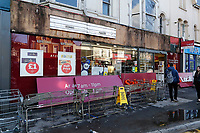 Pictured: The collapsed sign outside Sainsbury's in Swansea, Wales, UK.  Tuesday 13 February 2018<br /> Re: A Sainsbury's shop sign at the Uplands local store in the Uplands area of Swansea has collapsed onto the pavement hitting a woman in south Wales, UK.