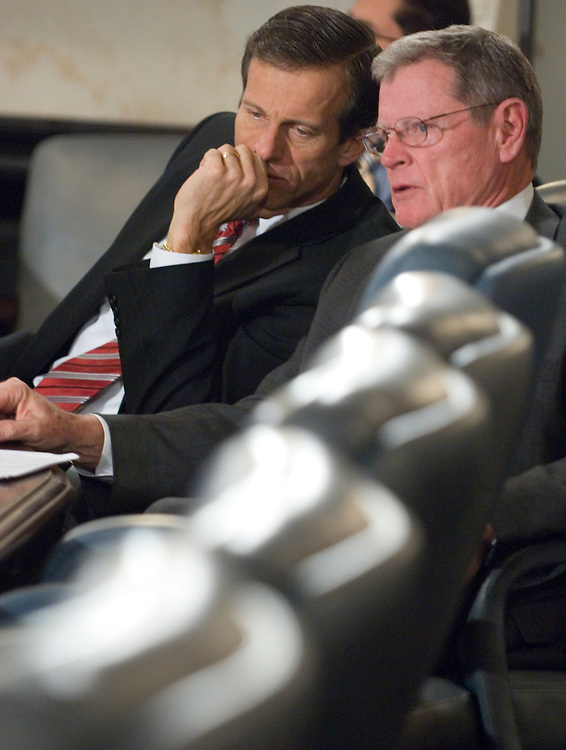"From left, Sen. John Thune, R-S.Dak., and Sen. James Inhofe, R-Okla., talk during the Senate Readiness and Management Support Subcommittee hearing on ""Urgent Reform Required: Army Expeditionary Contracting,"" on Thursday, Dec. 6, 2007."