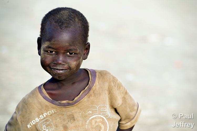 A displaced boy in Agok, a town in the contested Abyei region where tens of thousands of people fled in 2011 after an attack by soldiers and militias from the northern Republic of Sudan on most parts of Abyei. Although the 2005 Comprehensive Peace Agreement called for residents of Abyei--which sits on the border between Sudan and South Sudan--to hold a referendum on whether they wanted to align with the north or the newly independent South Sudan, the government in Khartoum and northern-backed Misseriya nomads, excluded from voting as they only live part of the year in Abyei, blocked the vote and attacked the majority Dinka Ngok population. The African Union has proposed a new peace plan, including a referendum to be held in October 2013, but it has been rejected by the Misseriya and Khartoum. The Catholic parish of Abyei, with support from Caritas South Sudan and other international church partners, has maintained its pastoral presence among the displaced and assisted them with food, shelter, and other relief supplies.