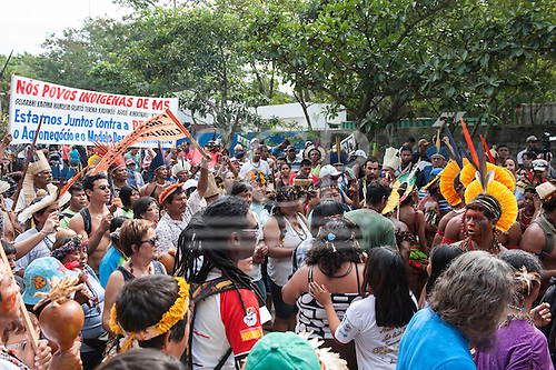 Indigenous people from the Brazilian state of Mato Grosso do Sul are marching to the beach for the Human Banner event, organised by the indigenous people to protest about the construction of hydroelectric dams on Brazil's rivers. The People's Summit at the United Nations Conference on Sustainable Development (Rio+20), Rio de Janeiro, Brazil, 19th June 2012. Photo © Sue Cunningham.