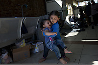 Pictured: Two young children at the passenger terminal Thursday 03 March 2016<br /> Re: Migrants have been gathering at the port of Piraeus, near Athens, Greece