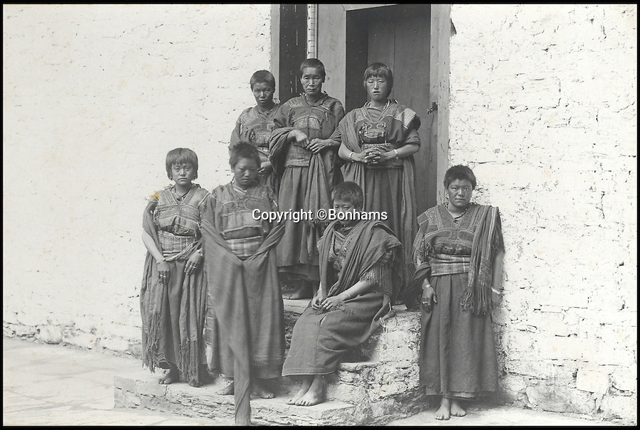 BNPS.co.uk (01202 558833)<br /> Pic: Bonhams/BNPS<br /> <br /> Sewing maids in old costumes.<br /> <br /> Fascinating 112 year-old photographs of Bhutan taken decades before the remote country in the Himalayas became open to outsiders have been unearthed.<br /> <br /> The images provide an unprecedented insight into the isolated kingdom nestled between India and China in the heart of the Himalayas at the beginning of the 20th century. <br /> <br /> The country was almost completely cut off for centuries as it sought to protect its ancient traditions and has only become more accessible to visitors since the 1970s. Such has been their desire to protect their heritage they didn't have TV until 1999.<br /> <br /> The photographs are believed to have belonged to the family of someone who took part in the expedition to Bhutan in 1905 and have since been passed to a private collector.<br /> <br /> The present owner has now decided to submit them for auction and they are tipped to sell for £15,000.